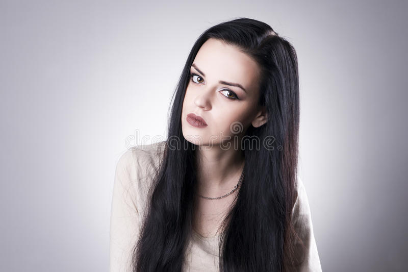 Beautiful woman portrait on a gray background. Professional makeup stock images