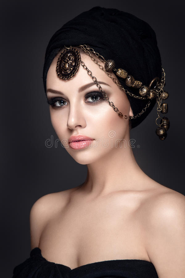 Beautiful woman portrait with headscarf on head. Beautiful woman portrait with headscarf and jewelry on head stock photos