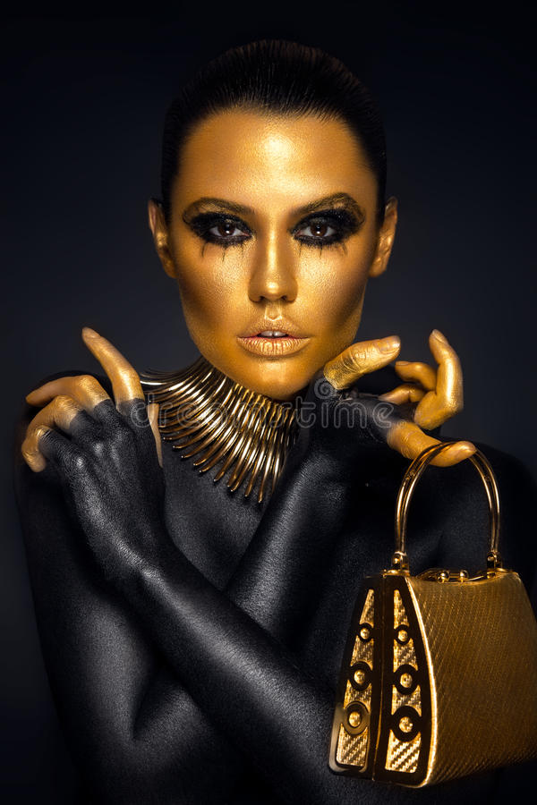 Free Beautiful Woman Portrait In Gold And Black Colors Stock Images - 81520664