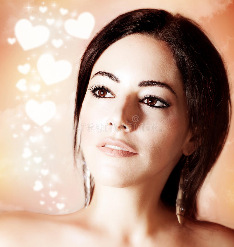 Beautiful woman portrait over romantic background royalty free stock image