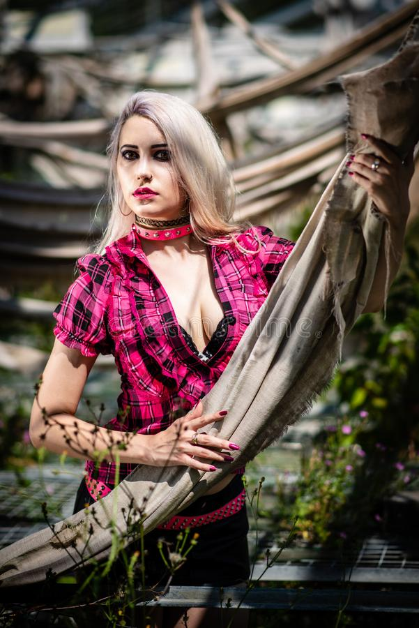 Beautiful woman portrait with punk make up and outfit royalty free stock image