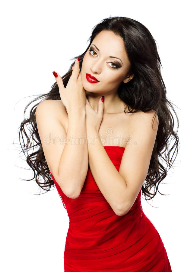Beautiful woman portrait with red lips and dress. Beautiful woman portrait with red lips, long curly black hairs in red dress over white background stock photo