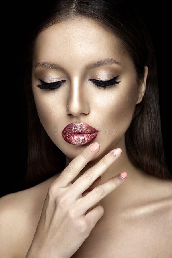 Beautiful woman portrait with shiny lipstick. Beautiful woman portrait with shiny lipstick on black background stock image