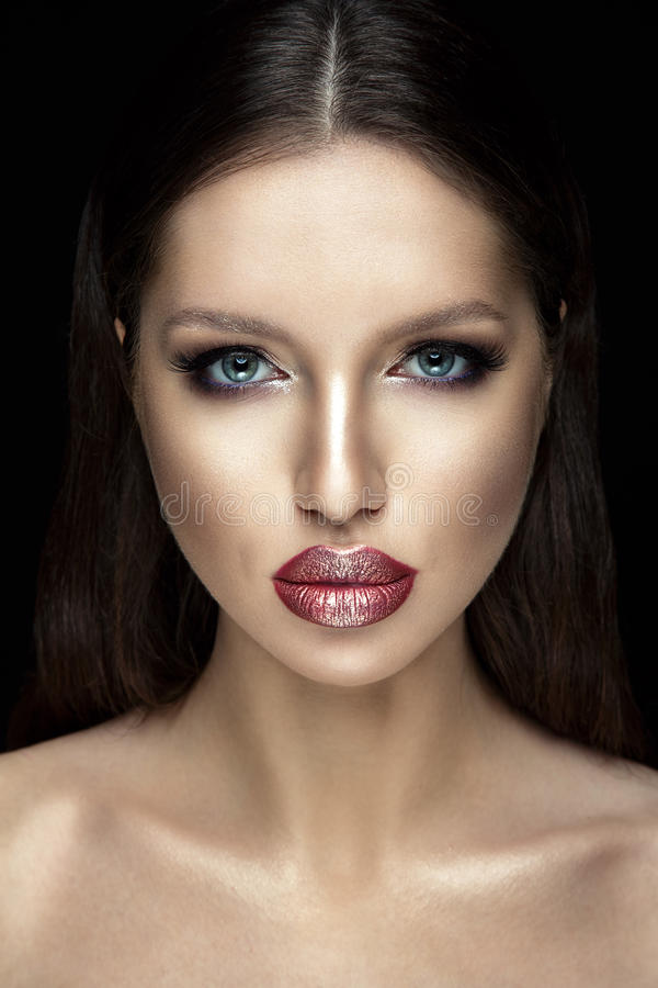 Beautiful woman portrait with shiny lipstick. Beautiful woman portrait with shiny lipstick on black background royalty free stock photos