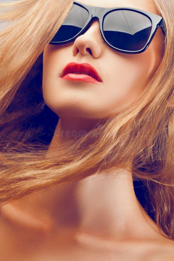 Beautiful woman portrait wearing sunglasses. Closeup fashion beautiful woman portrait with long hair wearing sunglasses stock image