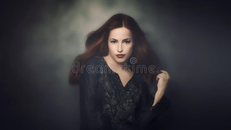 Beautiful woman portrait. Young beautiful woman portrait, studio shot stock photos