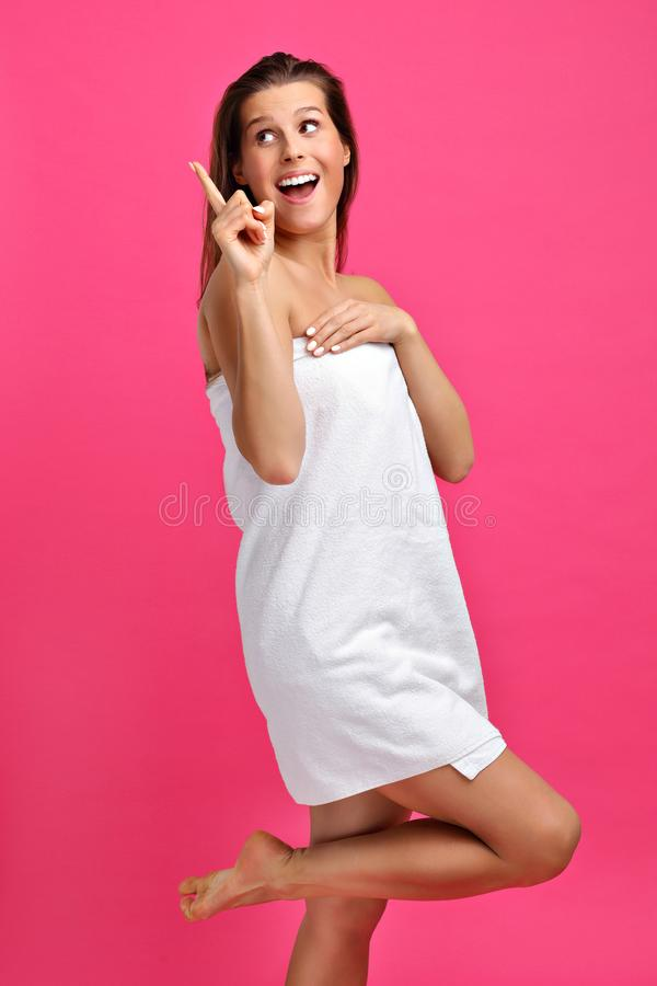 Beautiful woman posing against pink background stock photography
