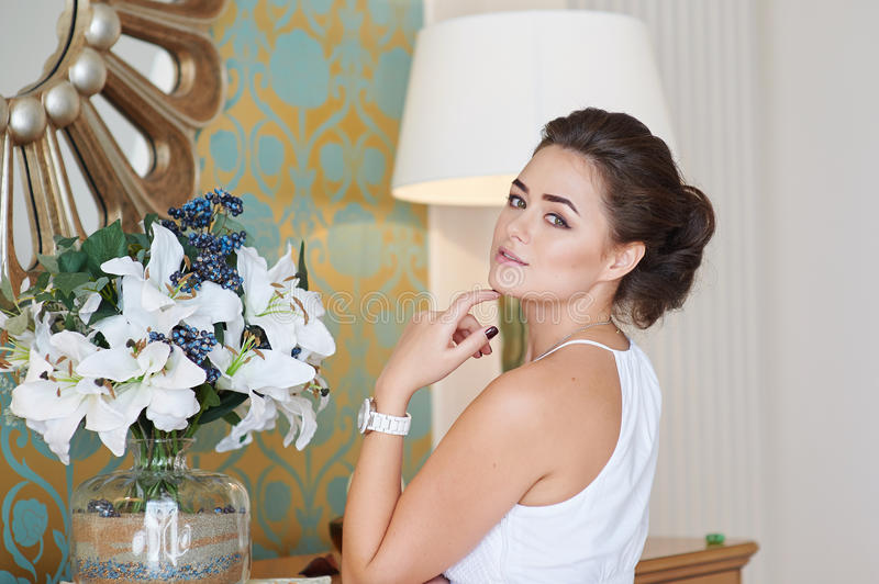 Beautiful woman posing in a luxurious room stock photo