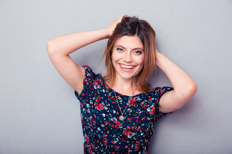Beautiful woman posing over gray background royalty free stock images