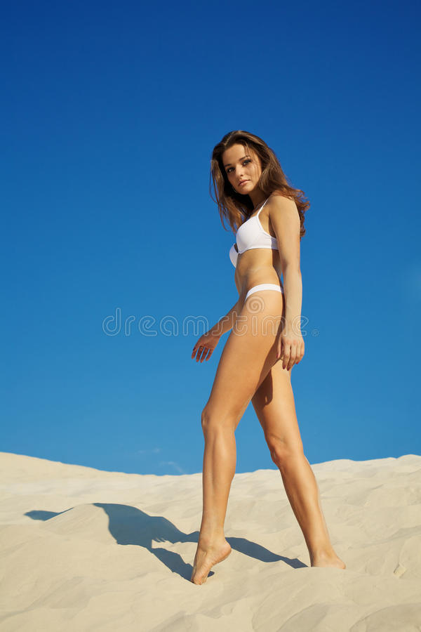 Download Beautiful Woman Posing On Sand Stock Image - Image: 15403283