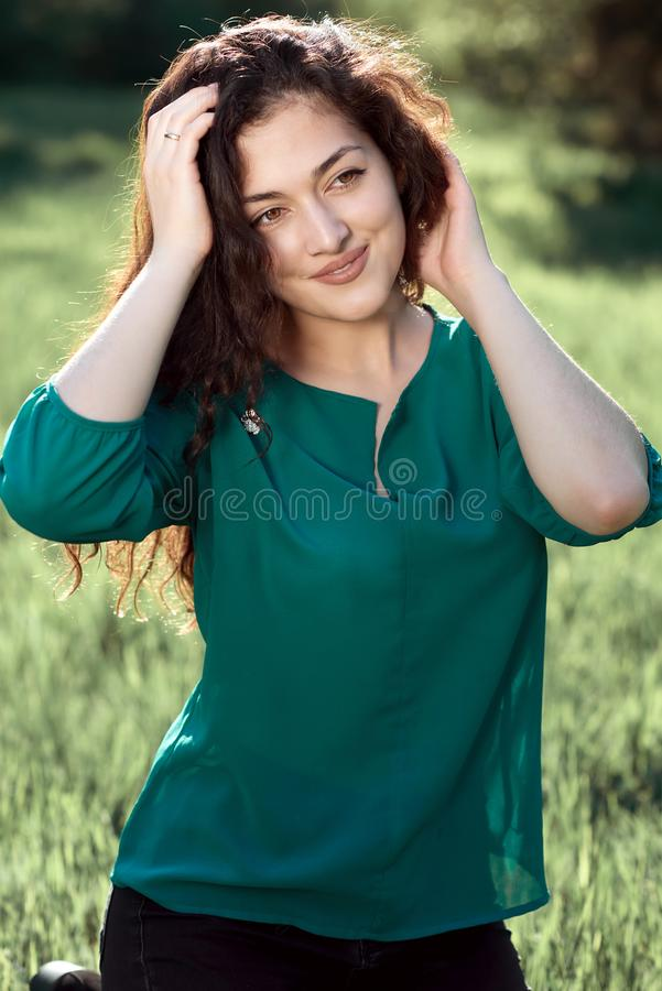 Beautiful woman posing in summer forest, bright landscape with shadows on the grass stock photo