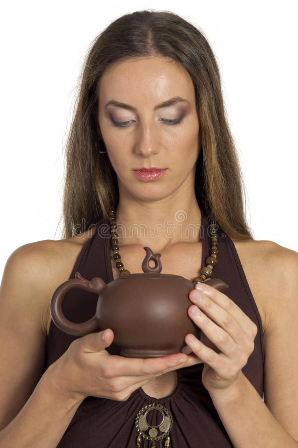 Beautiful woman with pot in hands stock images