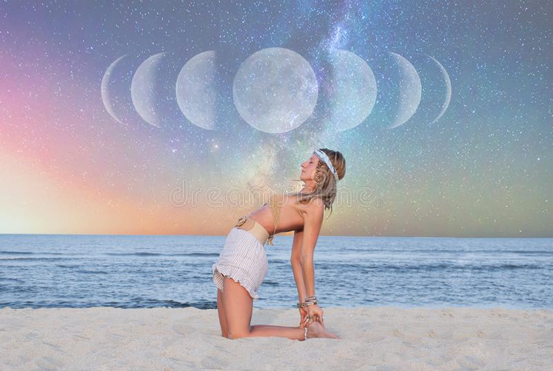 Beautiful woman is practicing yoga on the beach on Milky Way background stock photos