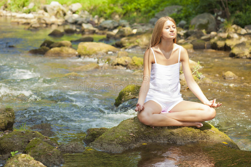 Download Beautiful Woman Practive Yoga On River In Nature Stock Image - Image: 20619341