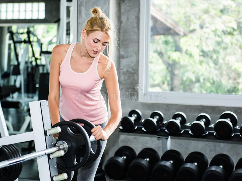 Beautiful woman prepare equipment for exercise stock photography