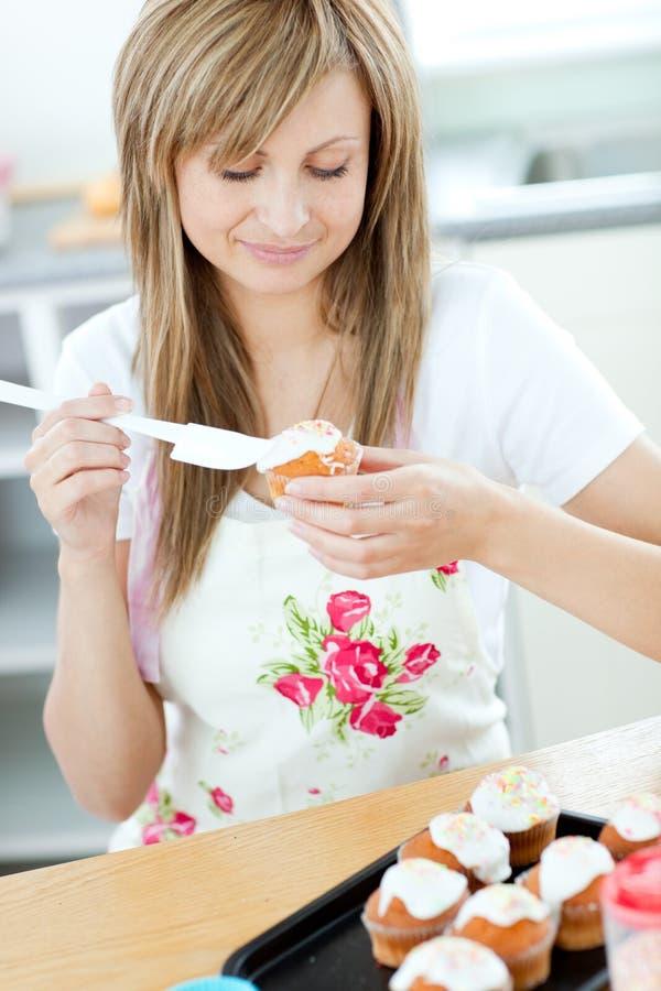Beautiful woman preparing cupcakes