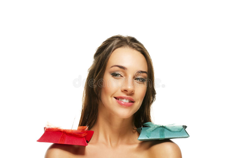 Beautiful Woman With Presents On Her Shoulders Royalty Free Stock Photos