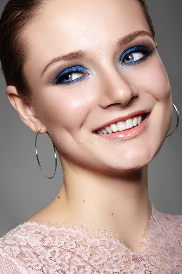 Beautiful Woman with Professional Blue Makeup. Celebrate Style Eye Make-up and Shine Skin. Smiling Fashion Model stock image
