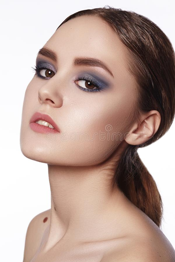 Beautiful Woman with Professional Makeup. Celebrate Style Eye Make-up, Perfect Eyebrows, Shine Skin. Bright Fashion Look.  royalty free stock images