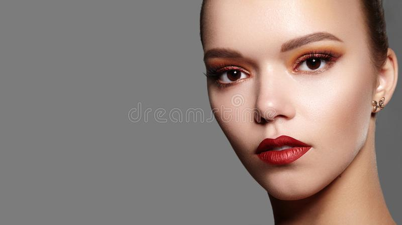 Beautiful Woman with Professional Makeup. Celebrate Style Eye Make-up, Perfect Eyebrows, Shine Skin. Bright Fashion Look.  stock images