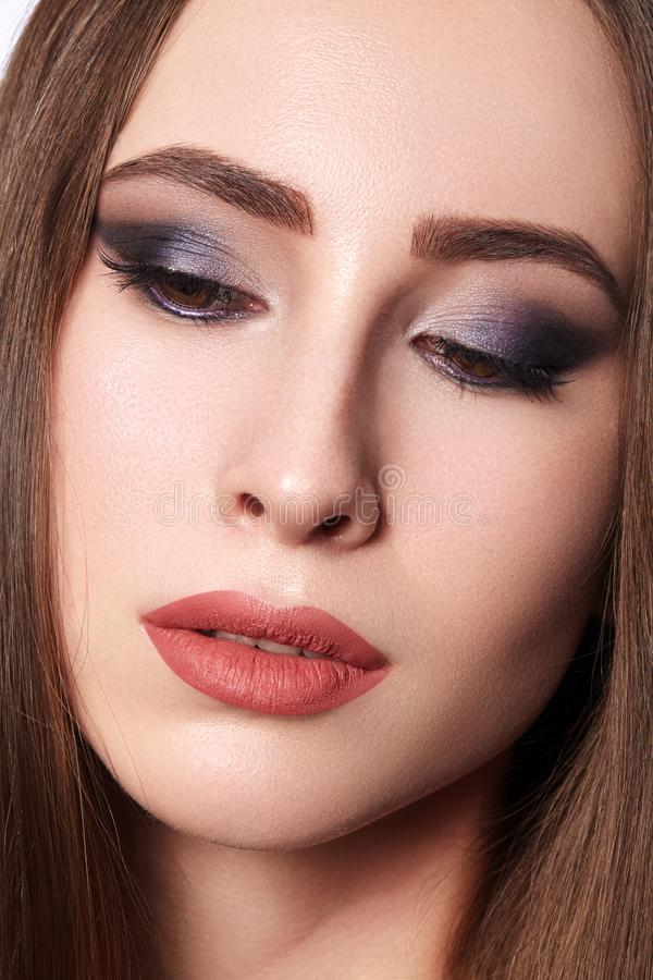 Beautiful Woman with Professional Makeup. Celebrate Style Eye Make-up, Perfect Eyebrows, Shine Skin. Bright Fashion Look.  stock photo