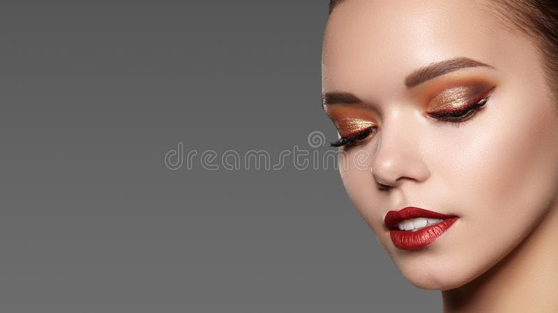 Beautiful Woman with Professional Makeup. Celebrate Style Eye Make-up, Perfect Eyebrows, Shine Skin. Bright Fashion Look stock photos