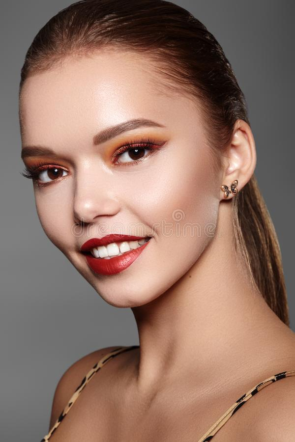 Beautiful Woman with Professional Makeup. Party Gold Eye Make-up, Perfect Eyebrows, Shine Skin. Bright Fashion Look royalty free stock images