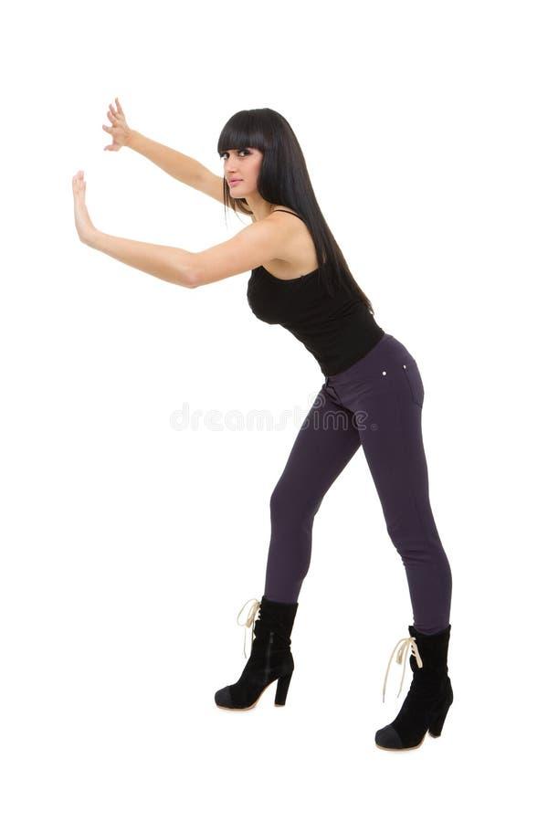 Download Beautiful Woman Pushing Something Stock Image - Image of attractive, posing: 17509401