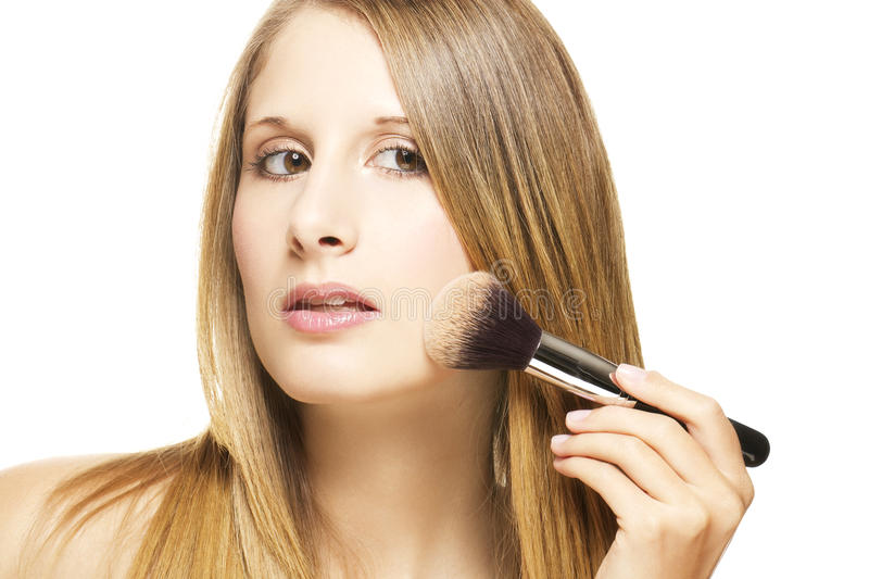 Beautiful Woman Put On Makeup With A Brush Royalty Free Stock Photos