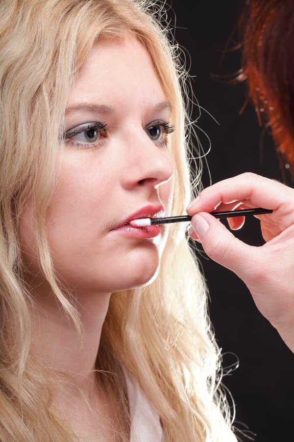 Download Beautiful Woman Putting On Makeup Stock Photo - Image: 22545576