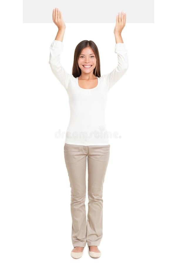 Beautiful Woman Raising Up An Empty Billboard stock photo