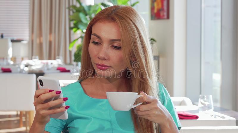 Beautiful woman receiving bad news on her smart phone stock images