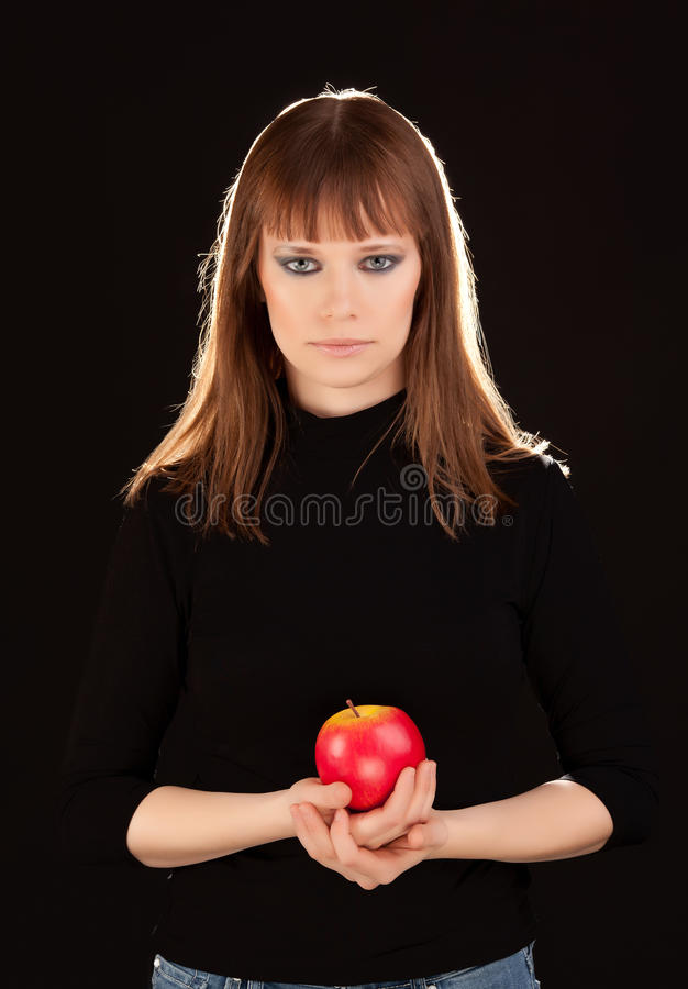 Beautiful woman with red apple stock photo