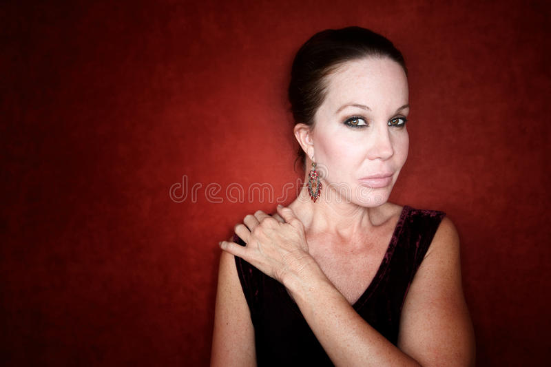Beautiful Woman on a Red Background royalty free stock photography