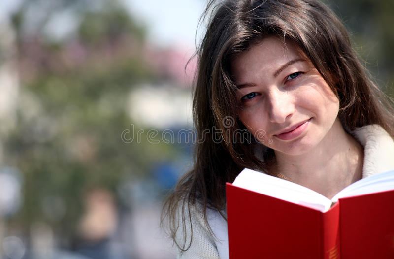 Beautiful woman with red book