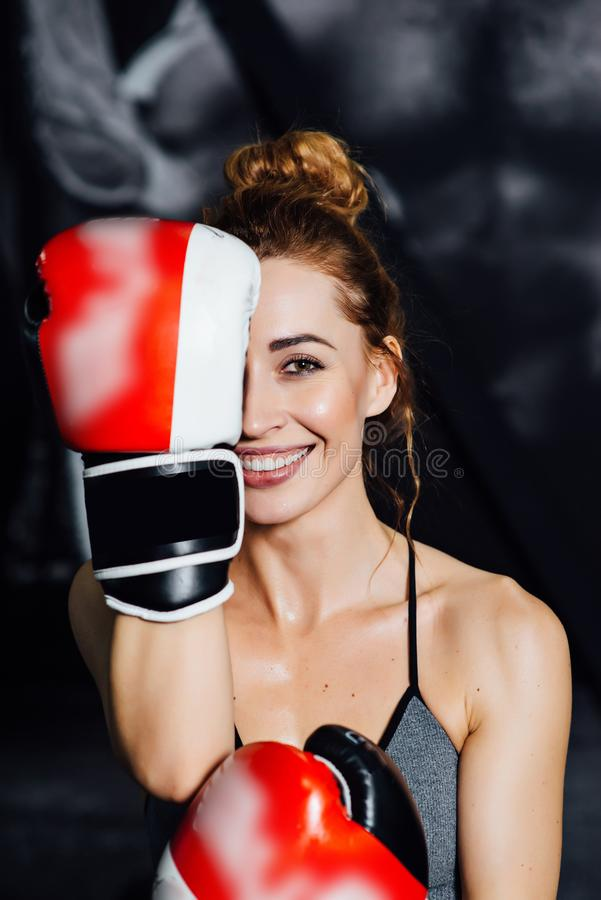 Beautiful Woman with the Red Boxing Gloves. stock photography