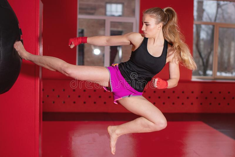 Beautiful Woman with the Red Boxing Gloves. Attractive Female Boxer Training. royalty free stock photography