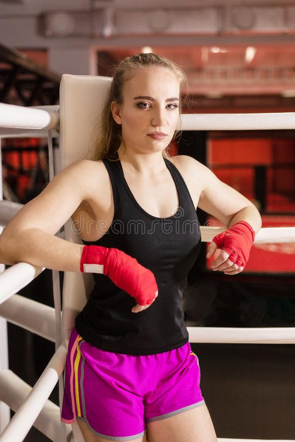 Beautiful Woman with the Red Boxing Gloves. Attractive Female Boxer Training. royalty free stock images