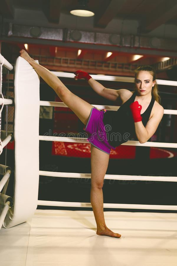 Beautiful Woman with the Red Boxing Gloves. Attractive Female Boxer Training. stock photo