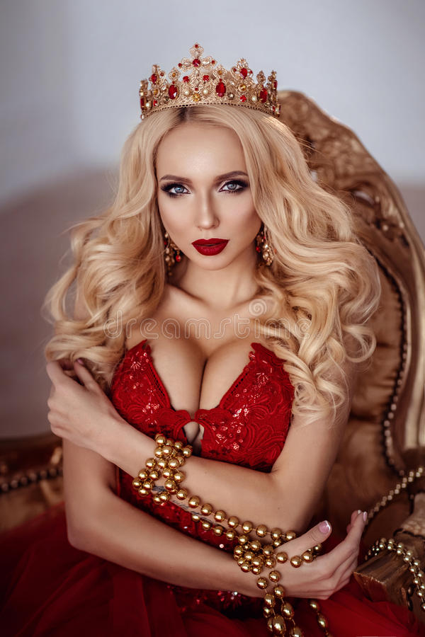 Beautiful woman in red dress and crown. Queen. Portrait. Portrait of beautiful woman in red dress and crown stock images