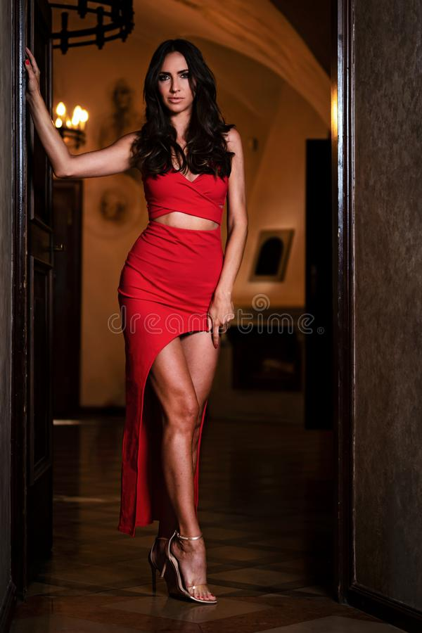 Beautiful woman in a red dress royalty free stock photos