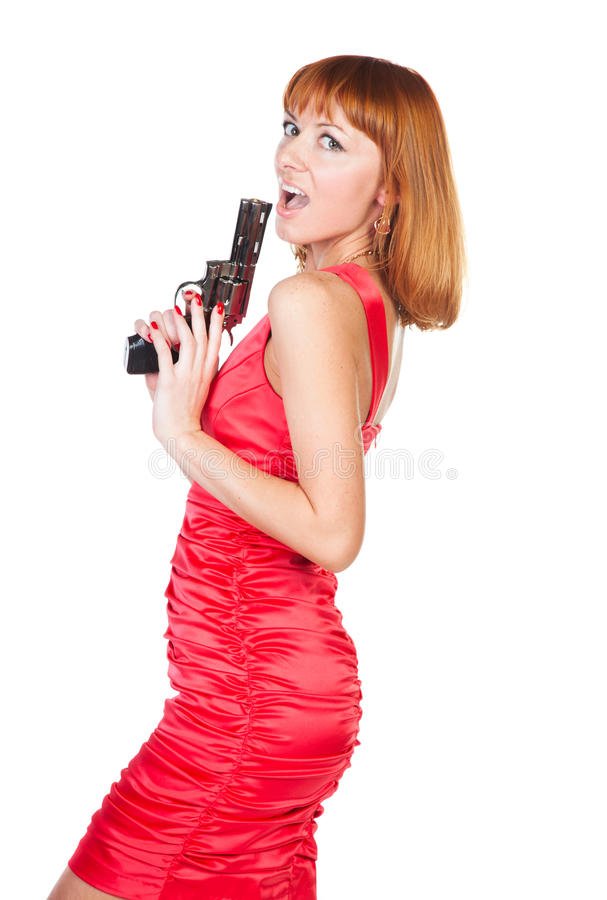 Beautiful woman in a red dress with a gun stock photography