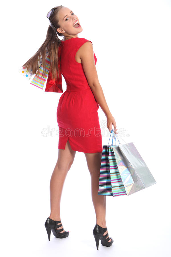 Beautiful woman in red dress has fun shopping royalty free stock images