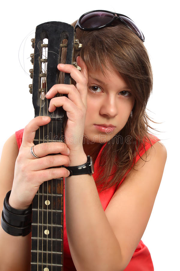 Beautiful Woman In Red With A Guitar Royalty Free Stock Photography