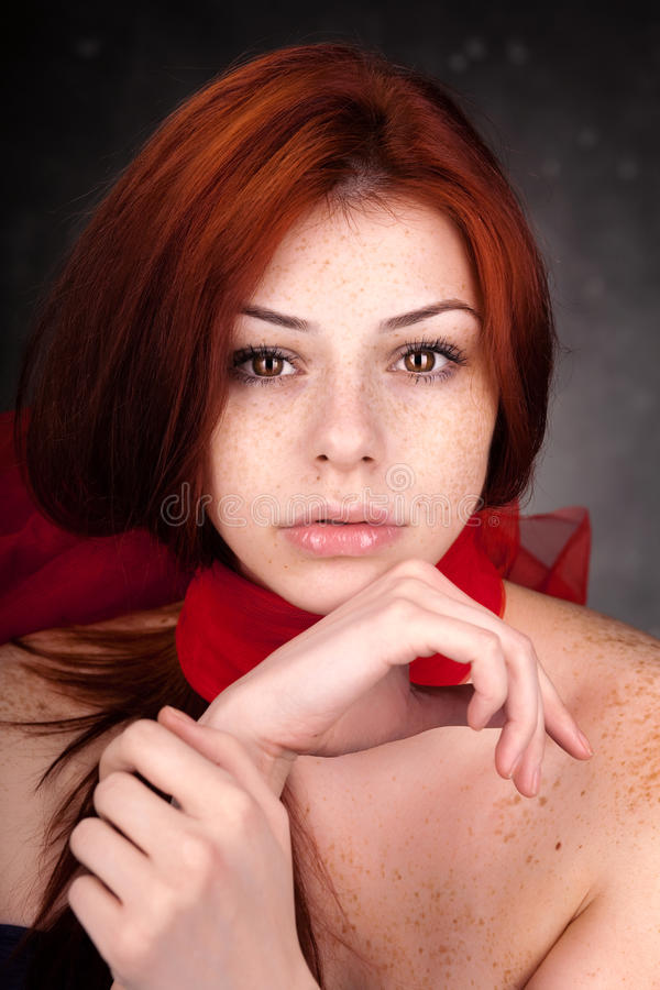 Beautiful woman with red hair and freckles