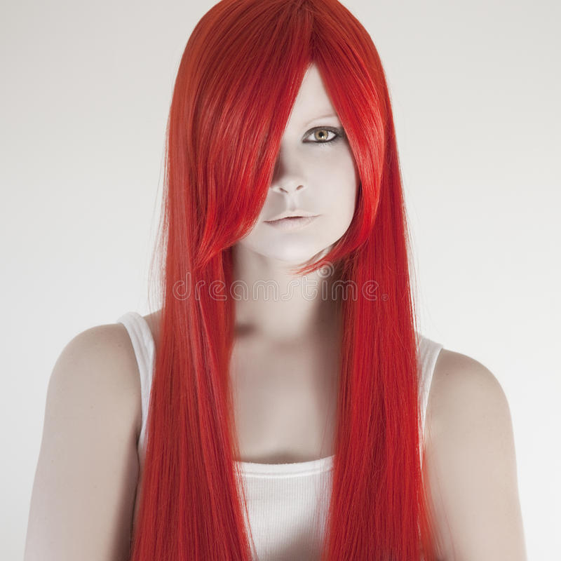 Beautiful woman with red hair. Studio shot royalty free stock photography