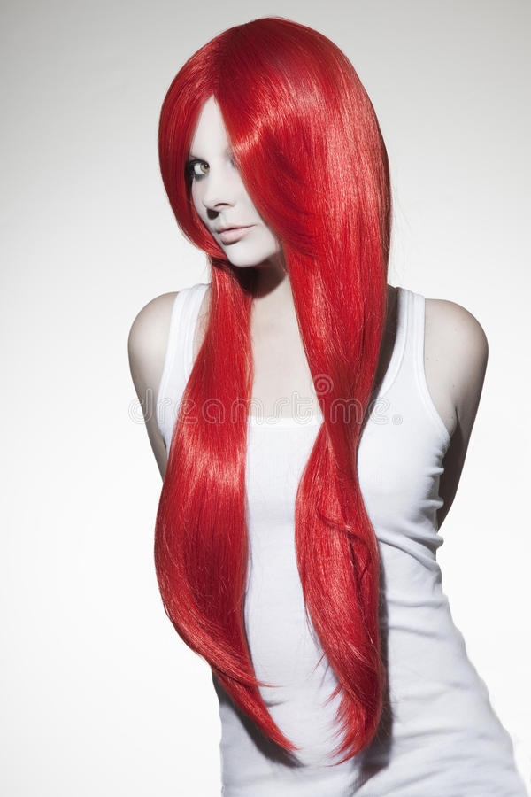Beautiful woman with red hair. Studio shot stock images