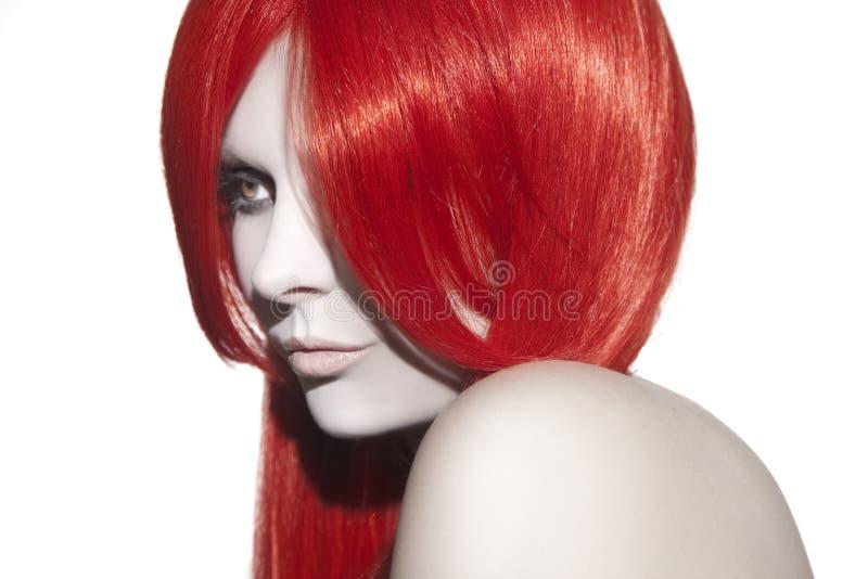 Beautiful woman with red hair. Studio shot stock photos
