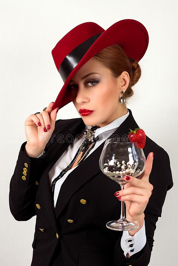 Beautiful woman with red lips, red hat and glass royalty free stock image