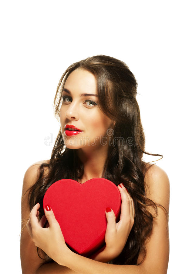 Beautiful woman with red lipstick holding red hear royalty free stock image